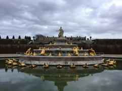 One of the beautiful fountains with the Palace of Versailled in the background