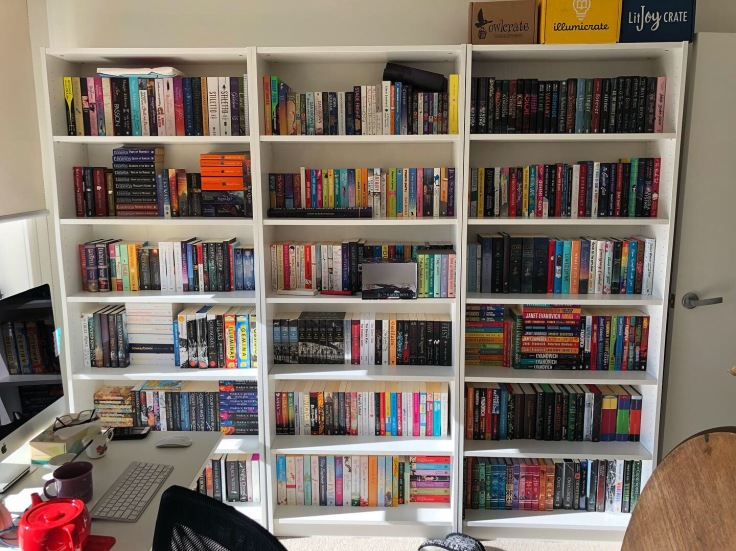 The other wall of books that is on the right of my desk.
