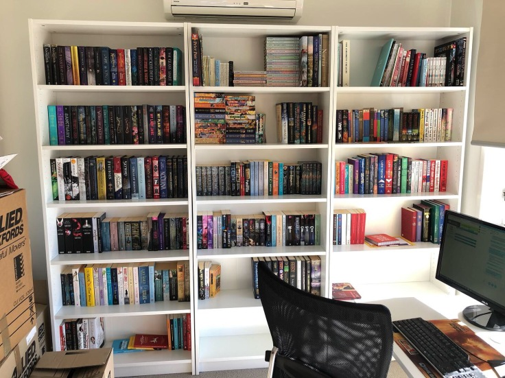 One wall of bookshelves that is to the left of my desk.