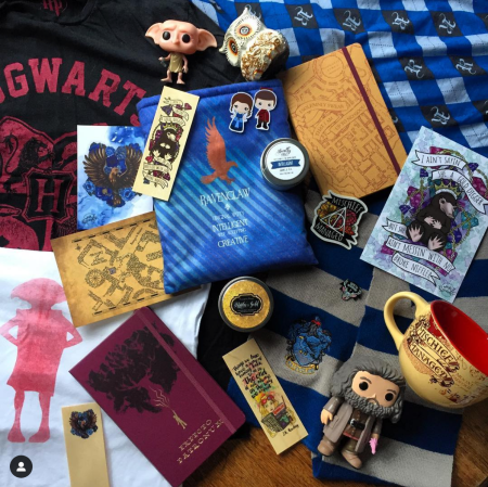 A giant pile of some of my Harry Potter related merchandise. Includes t-shirts, pajama pants, funkos, candles, bookmarks, book sleeves, prints, stickers, scarf, mugs, notebooks and figurines.